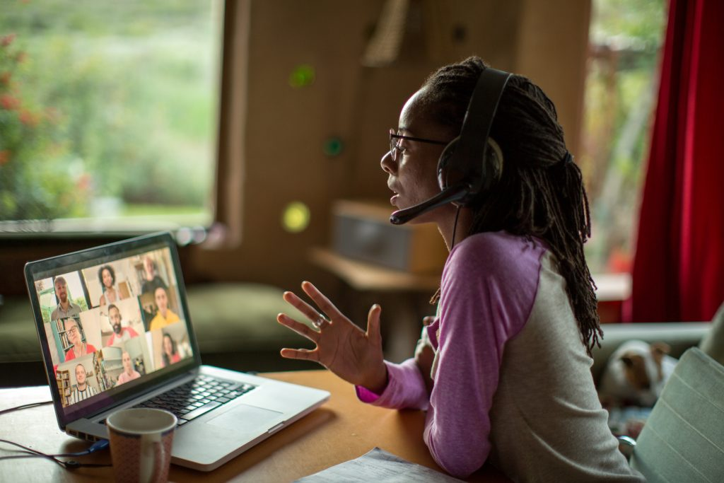 woman videoconferencing with headset